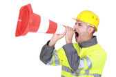 Traffic guard screaming into a pylon — Stock Photo