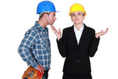 Angry foreman with helpless woman entrepreneur — Stock Photo