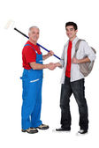 Decorator welcoming young starter — Stock Photo