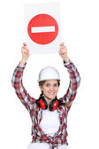 Worker holding warning sign — Stock Photo