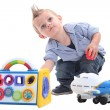 Young boy playing with toys in a studio — Stock Photo