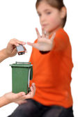 Kids illustrating improper disposal of batteries — Stock Photo