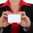 Woman holding a business card — Stock Photo