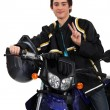 Stock Photo: Adolescent boy posing with his motorcycle