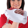 Brunette with electric mixer — Stock Photo #17087129