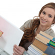 Young woman working on an assignment — Stock Photo