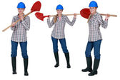 Woman standing with shovel — Stock Photo