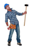 Bandaged construction worker wary of a sledgehammer — Stock Photo
