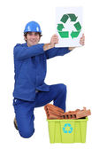 Manual worker encouraging to recycle — Stock Photo