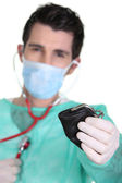 Surgeon auscultating a purse — Stock Photo