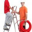 Stock Photo: Electricians greeting each other