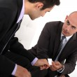Businessmen exchanging cards — Stock Photo