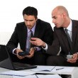 Two businessman discussing work - Stock Photo
