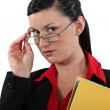 Clerical worker peering over her glasses — Stock Photo #17122013