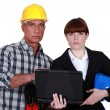 Architect and engineer with a laptop — Stock Photo