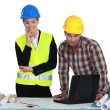 Tradesman and engineer working together — Stock Photo
