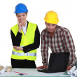 Stock Photo: Tradesman and engineer working together