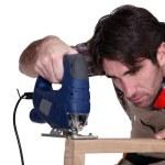 Carpenter using a jigsaw — Stock Photo #17125125