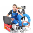 Stock Photo: Tradeswoman surrounded by building materials and technology
