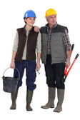 Tradesman and his assistant staring sideways — Stock Photo