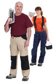 Tiler and young female assistant — Stock Photo