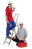 Electrician training young worker — Stock Photo