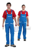 Painters with blue overalls and red-shirt — Stock Photo