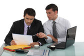 Two businessmen working on a project. — Stock Photo