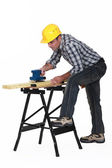 Carpenter using an electric sander — Stock Photo