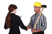 Female architect greeting builder — Stock Photo