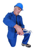 Man using a spanner on empty copyspace — Stock Photo