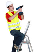 Man with a cordless drill — Stock Photo