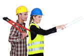 Female architect giving orders — Stock Photo