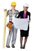 Woman carpenter and businesswoman — Stock Photo