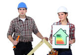 Couple stood with energy rating — Stock Photo