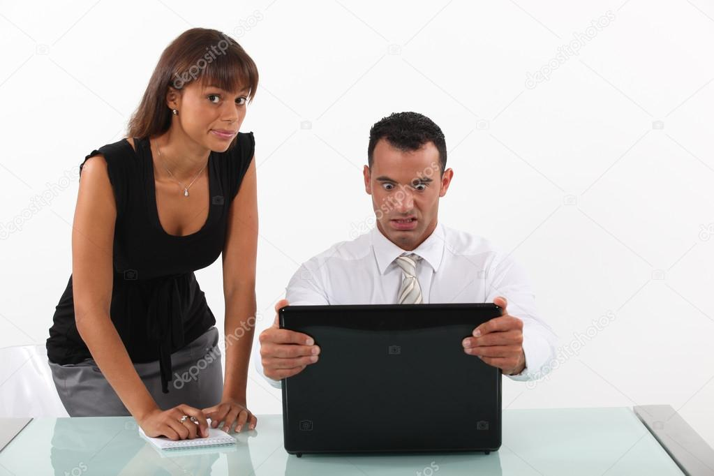 Businessman in front of his laptop looking surprised — Stock Photo #17123169