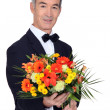 Man with bouquet of flowers — Stock fotografie