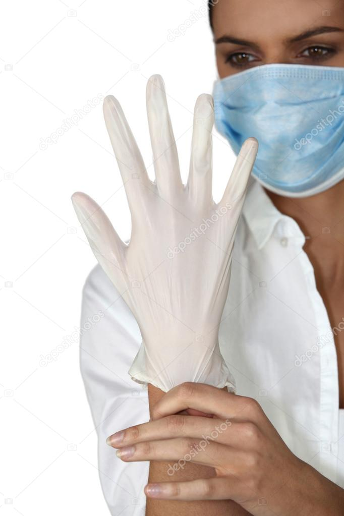 Doctor putting on rubber glove  Stock Photo #17198641