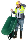 Man with a wheelbarrow having an accident — Stock Photo