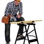 A mature carpenter with a circular saw. — Stock Photo #17212901