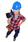 Woman holding a cordless drill — Stock Photo
