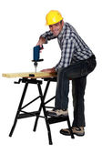 Man using a drill at a workbench — Stock Photo