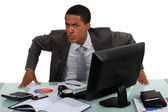 Un uomo d'affari infastidito — Foto Stock