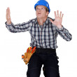Tradesman confined by a glass wall — Stock Photo