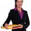 Businesswoman holding files — Stock Photo #17309465