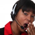Woman with headset yawning — Stock Photo