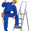 Carpenter pointing upwards — Stock Photo #17324541
