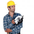 Stock Photo: Mholding circular-saw