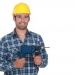 Confident handyman posing with power drill — Stock Photo #17325175