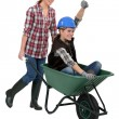 Stock Photo: Women with a wheelbarrow
